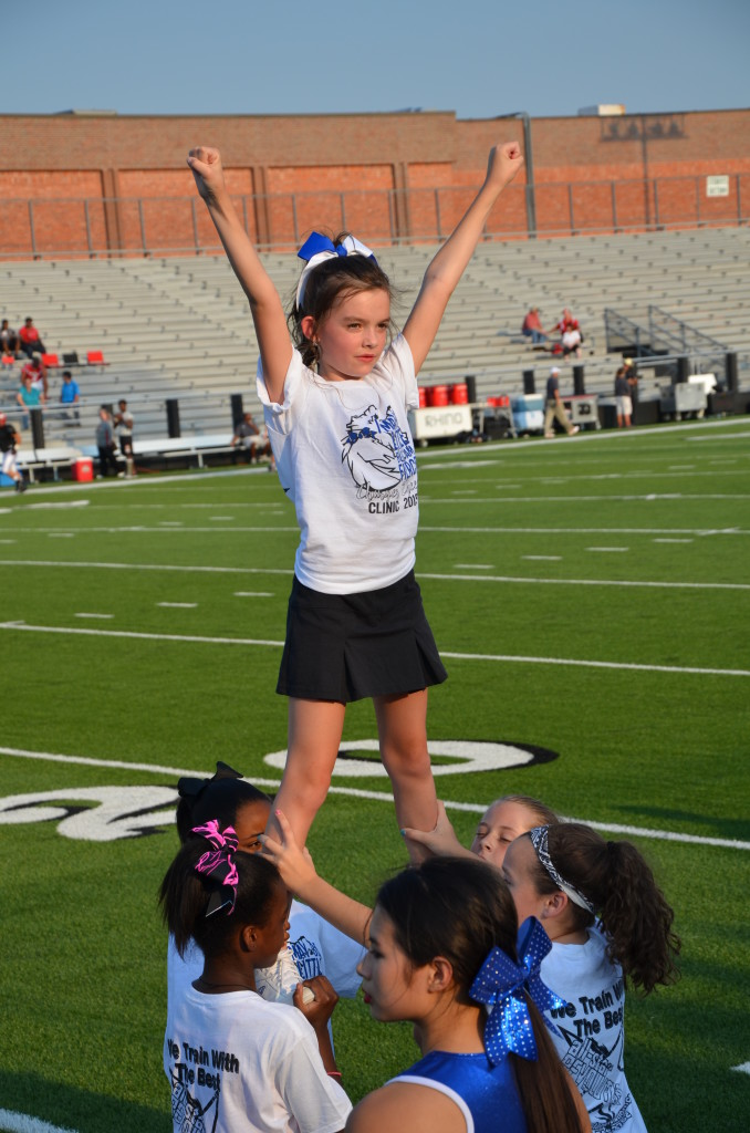 8-29-15 aiden and annslee cheer at varsity game 010