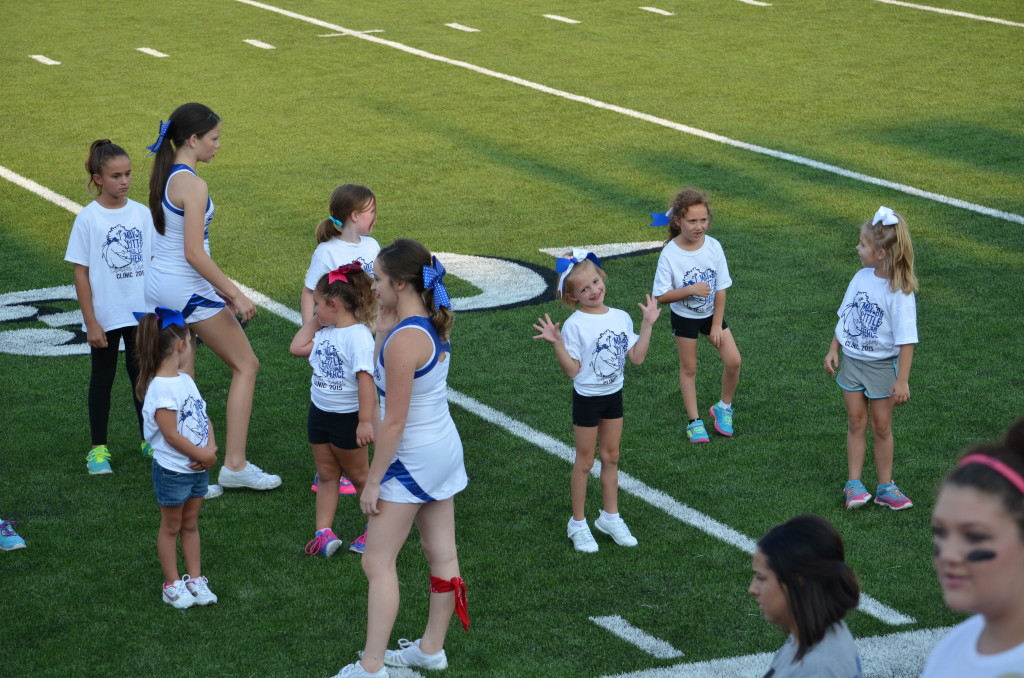 8-29-15 aiden and annslee cheer at varsity game 011